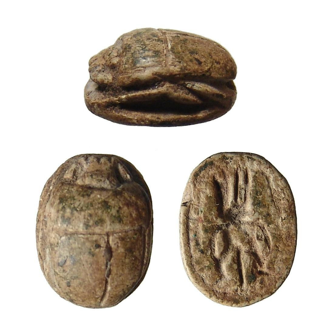 An Egyptian brown steatite scarab, New Kingdom