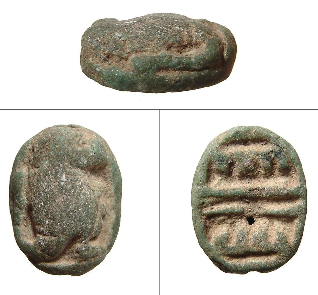 Egyptian green faience scaraboid in the form of a