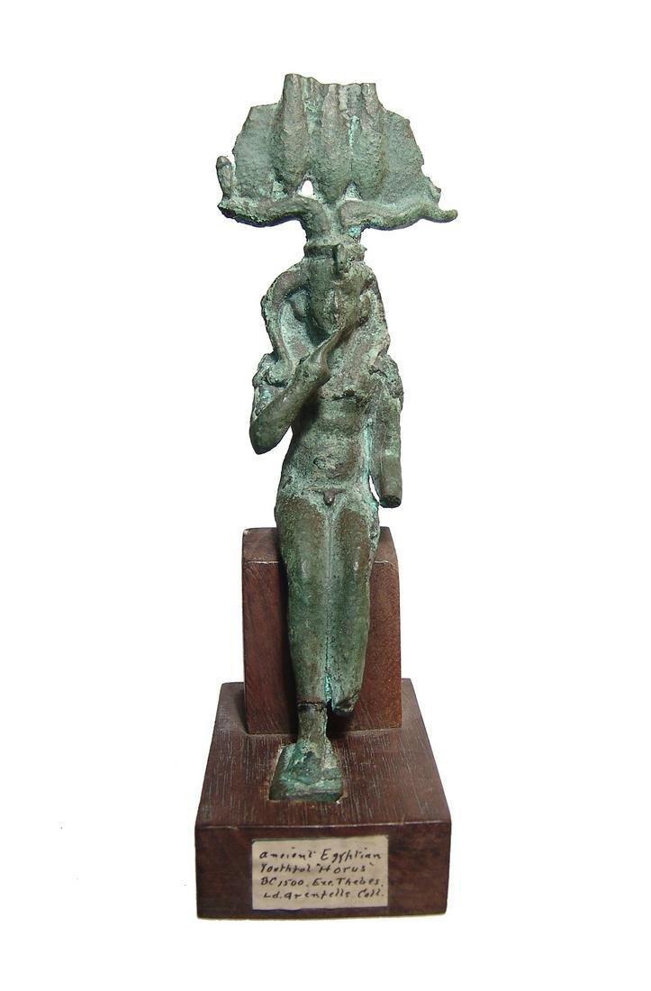 Large Egyptian bronze figure depicted Harpokrates