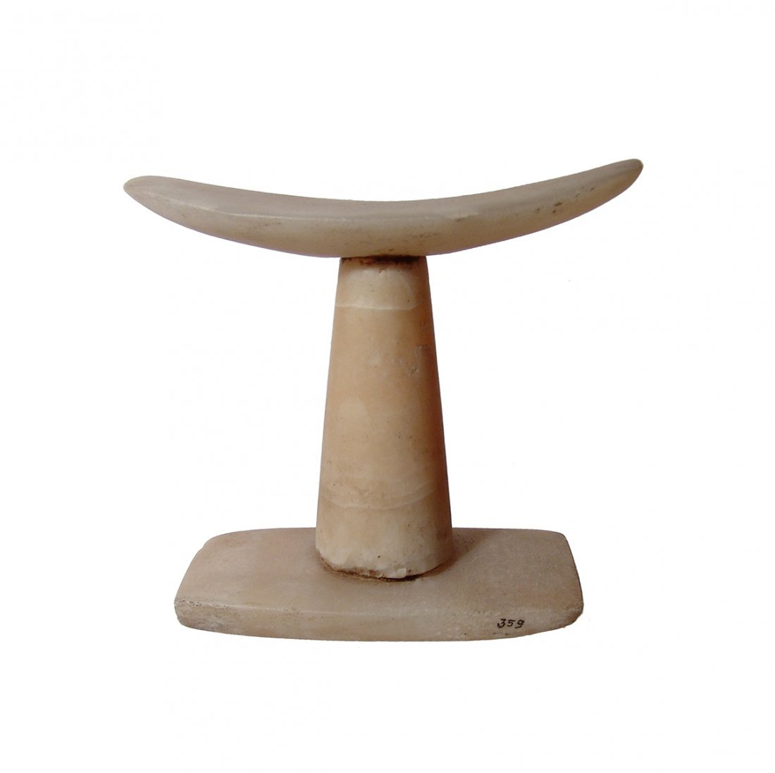 A choice Egyptian alabaster headrest, Middle Kingdom