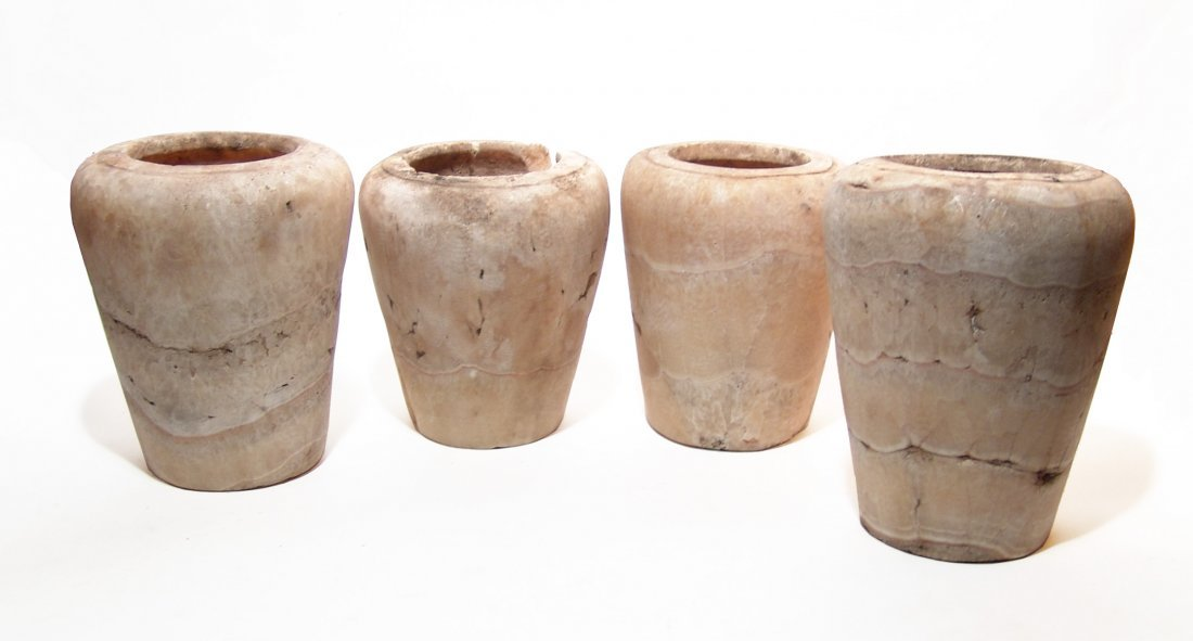 A set of 4 large Egyptian alabaster canopic jars