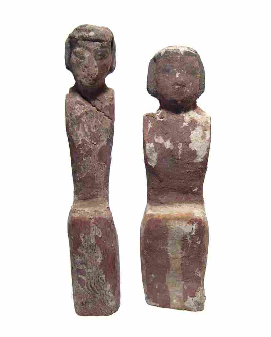 A pair of Egyptian wood figures, Middle Kingdom