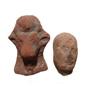 A terracotta male head and an Apis bull, Roman Period