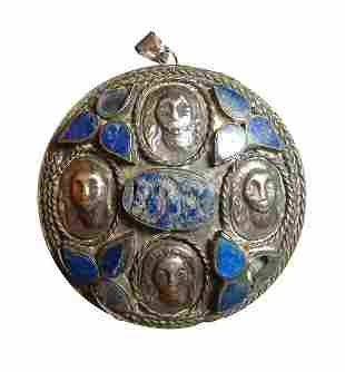 An antique silver and lapis round pendant