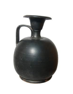 A Greek black-ware squat lekythos