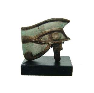 A large Egyptian bicolor faience Eye of Horus amulet