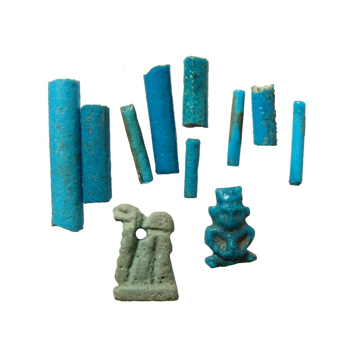 A mixed lot of Egyptian faience beads and amulets