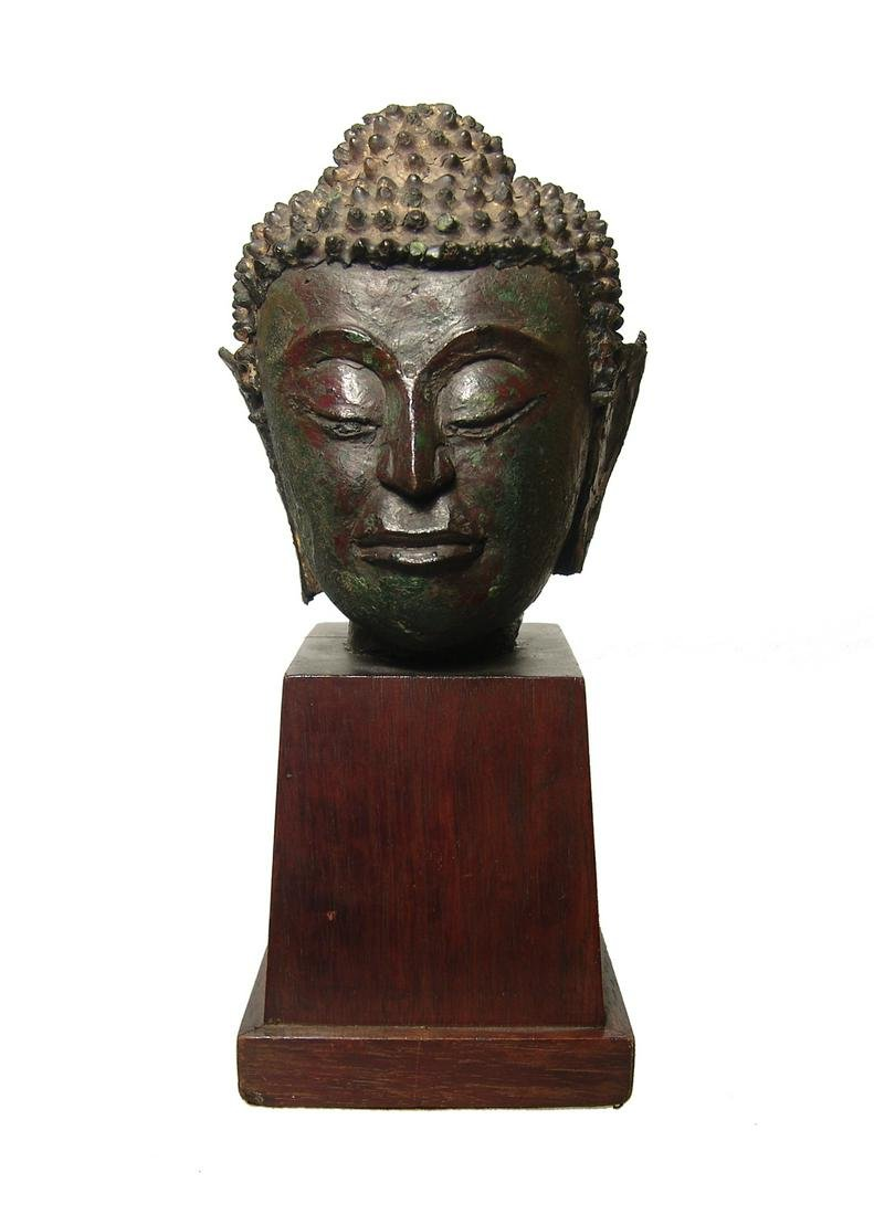 A large and attractive bronze head of Buddha