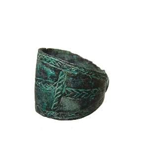 A Near Eastern bronze cuffed band