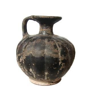 A Greek black glazed squat lekythos
