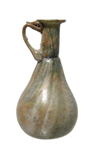 An attractive Roman green glass sprinkler vessel