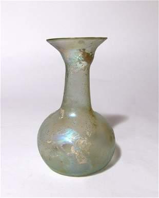 An attractive Roman pale green glass bottle