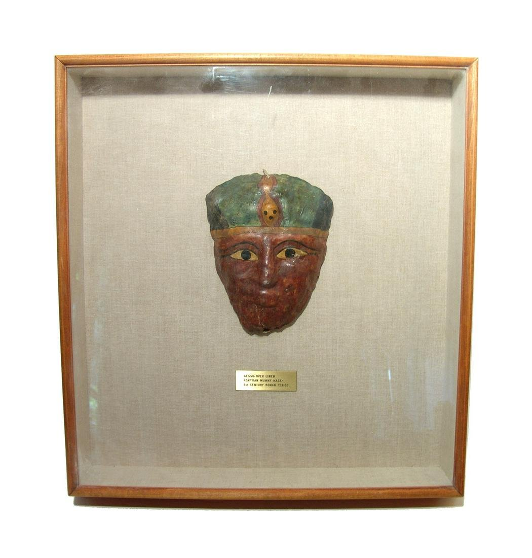 A nicely framed Egyptian painted mummy mask