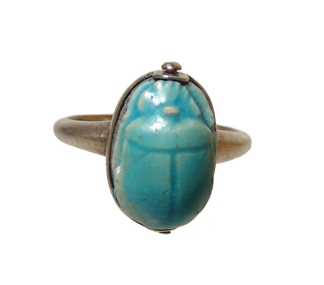An Egyptian faience scarab in silver ring