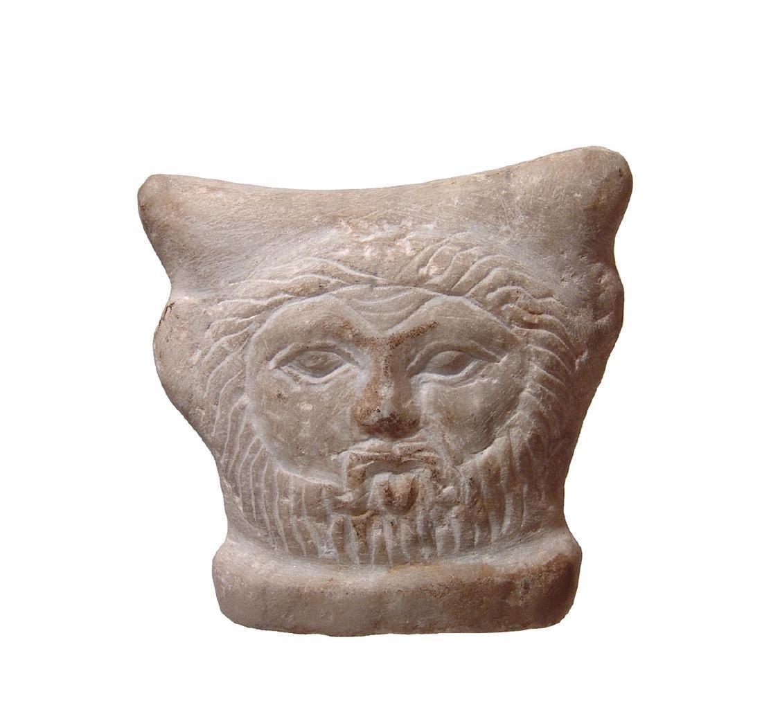 A fantastic Romano-Egyptian marble child's headrest