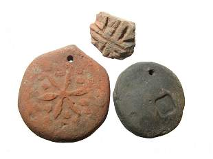 Pair of Byzantine loom weights and spindle whorl