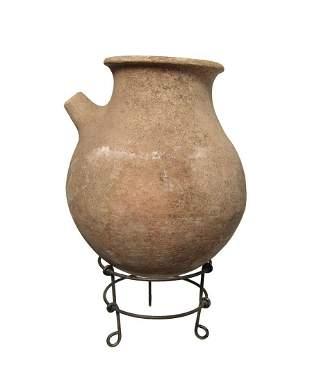 A Bronze Age spouted vessel