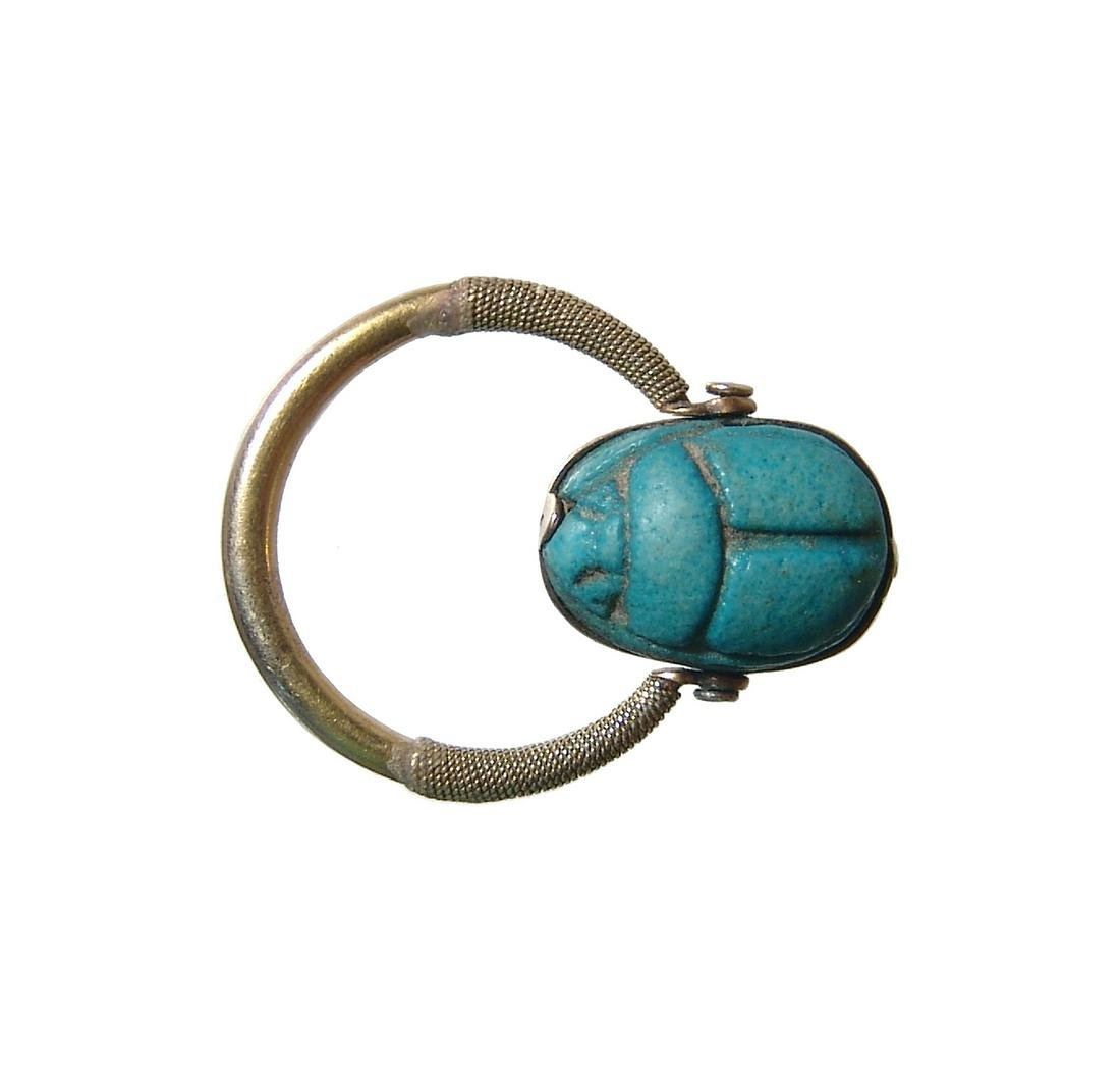 Egyptian faience scarab set in a lovely gold swivel