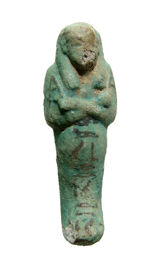 An Egyptian bicolor faience ushabti, Dynasty 21