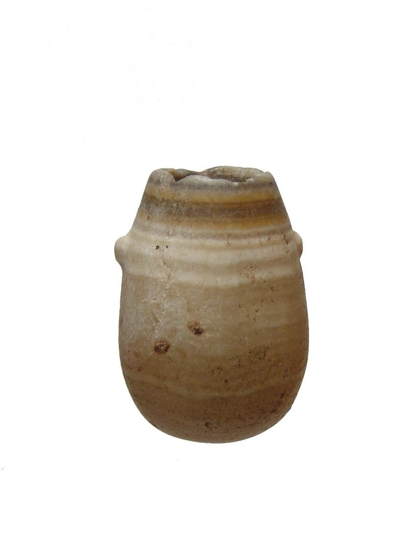 An Egyptian alabaster kohl jar, Late Period