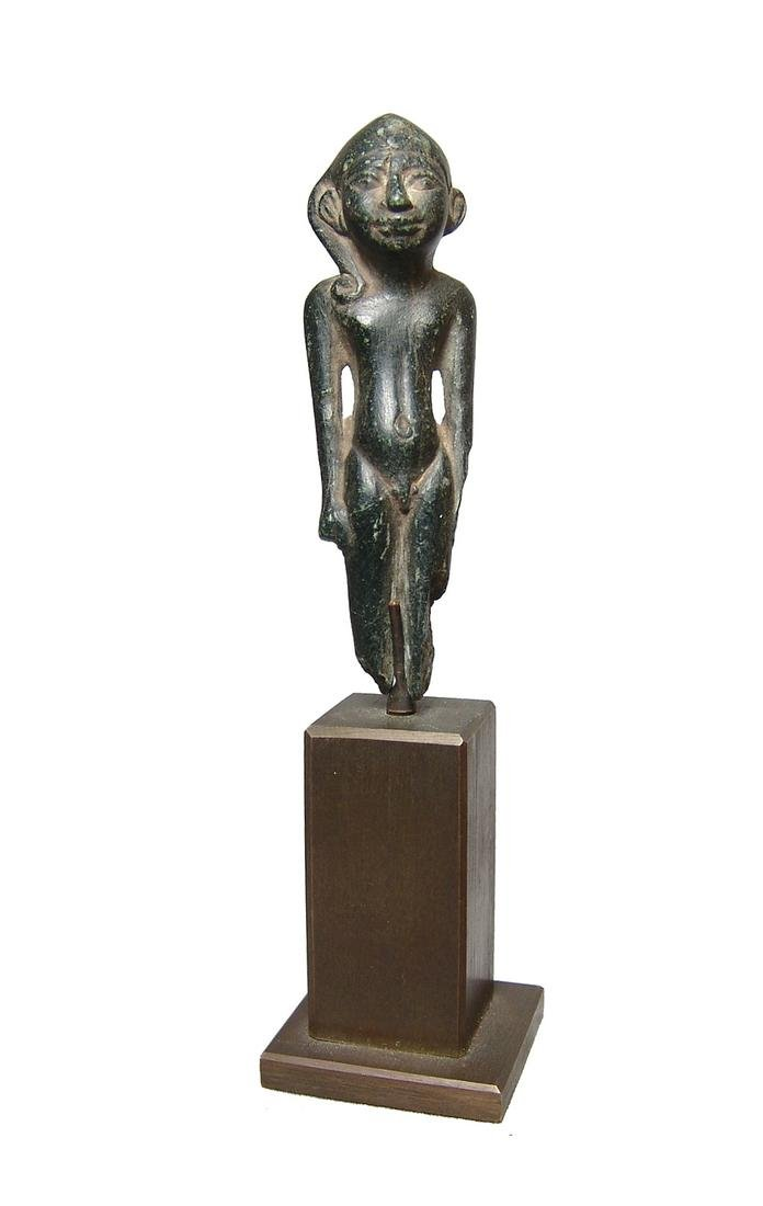 A lovely Egyptian black steatite figure of Harpokrates