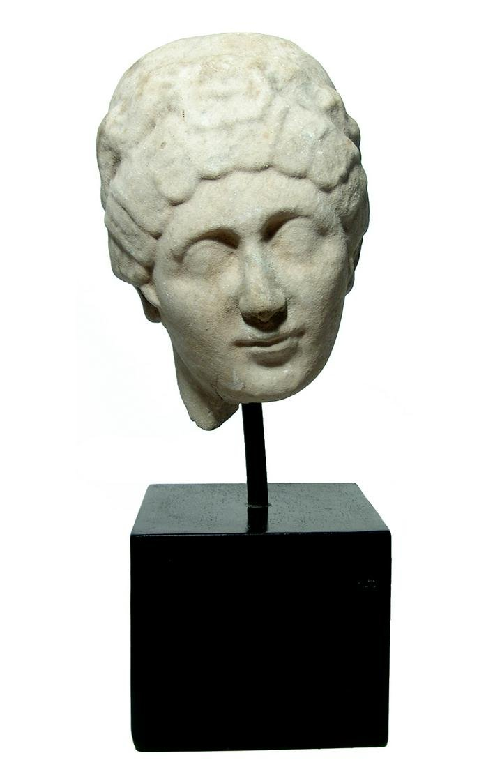 A lovely Roman marble head of a woman