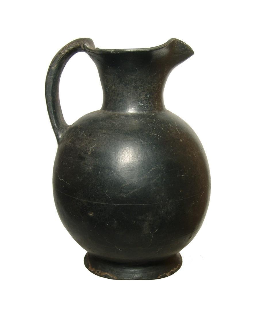 A lovely Etruscan bucchero trefoil olpe