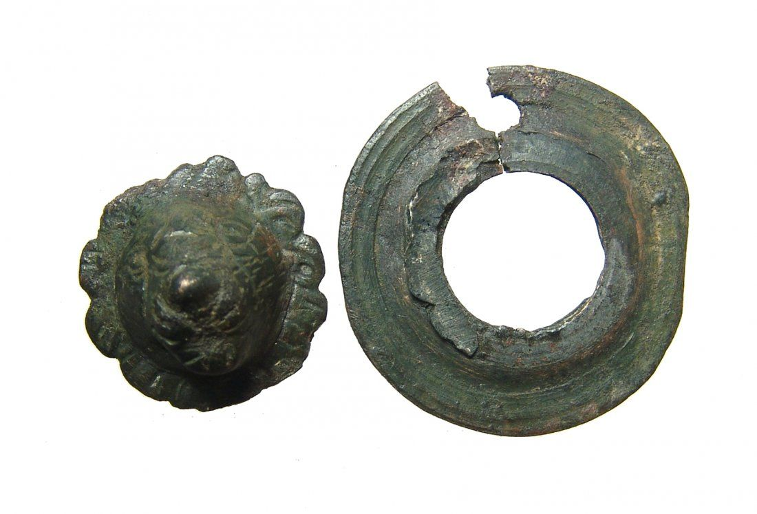 Roman bronze applique in the form of a facing lion