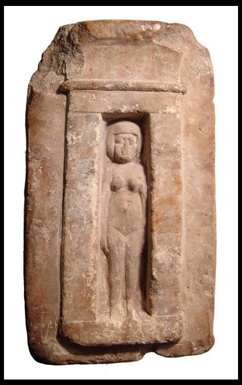 7: Egyptian limestone shrine with nude female