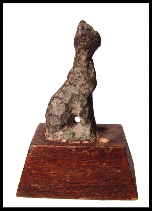 21: Late Period Egypt. Bronze seated cat