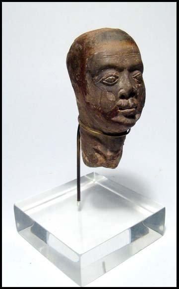 18: Roman Egypt, limestone head of a bearded male