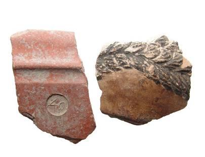 Ancient stucco mask fragment & antique brick fragment