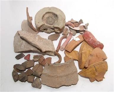A large group of ancient pottery fragments