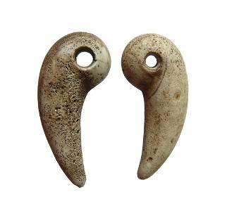 A pair of antique ceramic animal claws