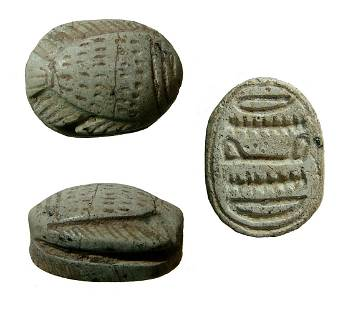 A New Kingdom Egyptian steatite scarab with fish