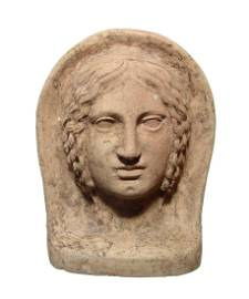 A wonderful Etruscan terracotta votive head of a woman