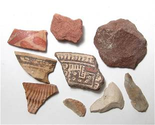 A collection of ancient pottery and stone fragments