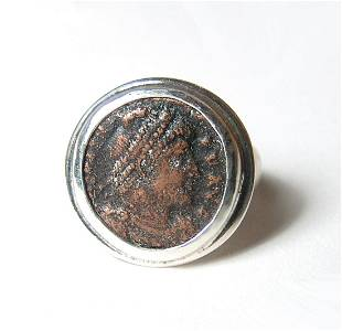 A silver ring set with a Roman bronze coin
