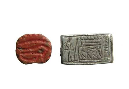An Egyptian silver plaque and amulet