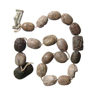 A strand of 16 Egyptian scarabs and a pair of amulets