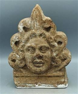 An Etruscan terracotta antefix fragment