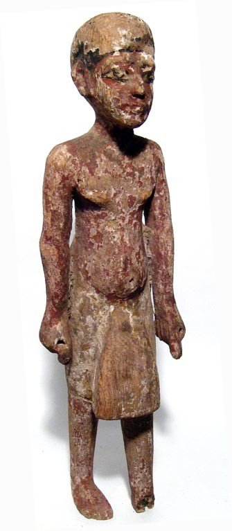 5: New Kingdom wooden statue of a priest