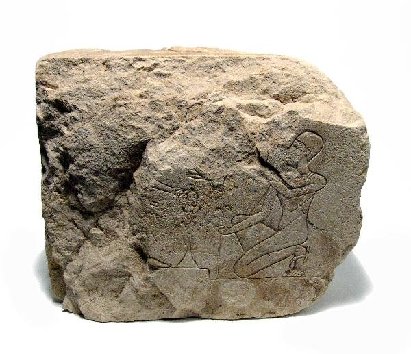 15: Ptolemaic limestone relief with kneeling priest