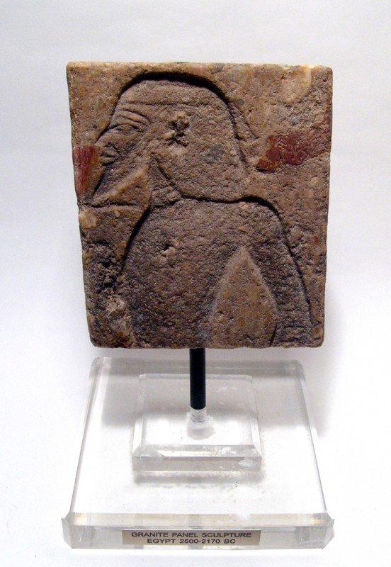 3: Old Kingdom granite relief depicting a captive