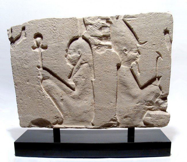11: Choice limestone relief: Ma'at and Osiris