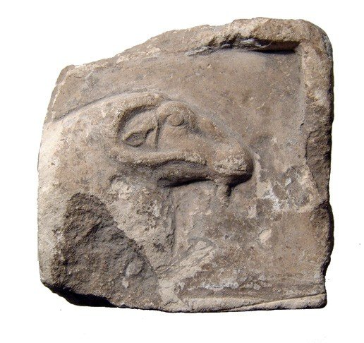 12: Limestone relief depicting the head of Khnum