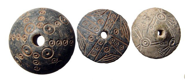 17: Three nicely carved Coptic spindle whorls