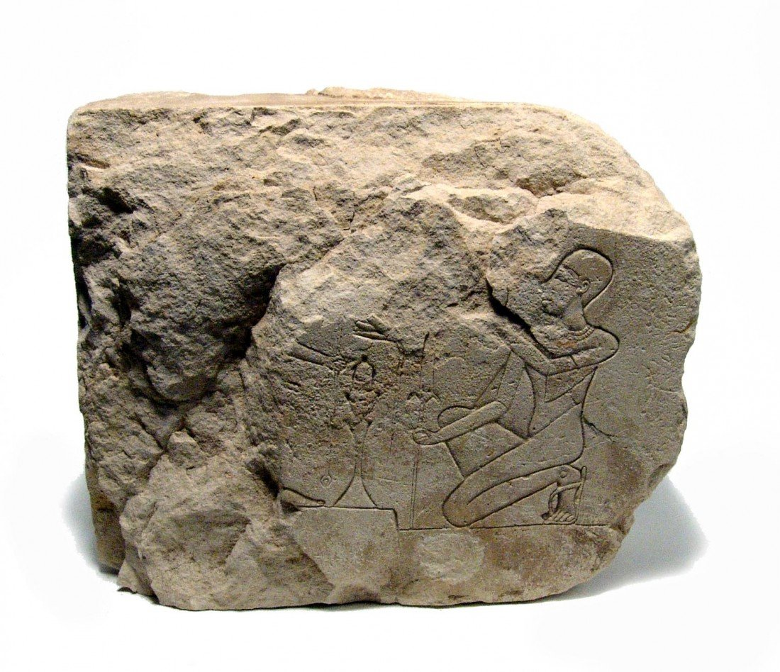 17: Ptolemaic limestone relief w/ kneeling priest