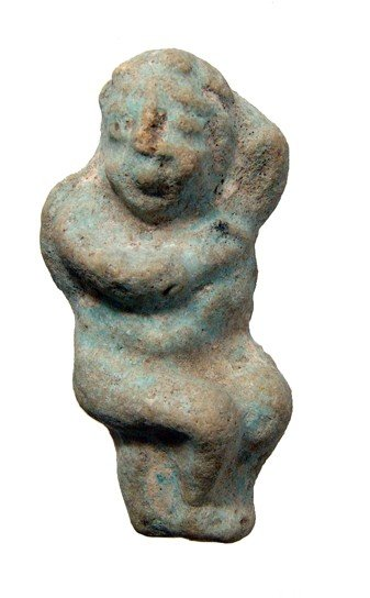 18: Egyptian light blue faience amulet of Eros