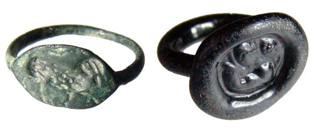 8: A pair of ancient rings - bronze and glass